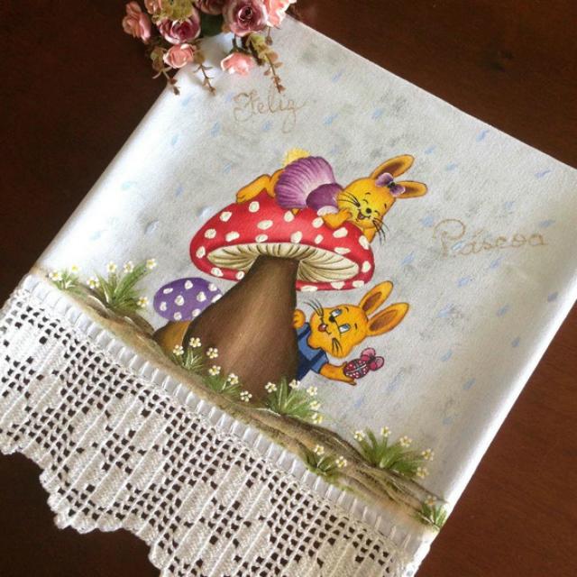 Pintura de coelhos em pano de prato